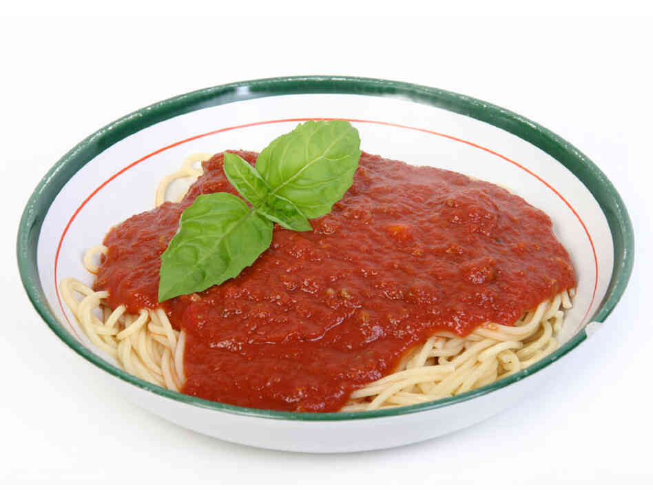 Bowl of pasta with sauce and basil