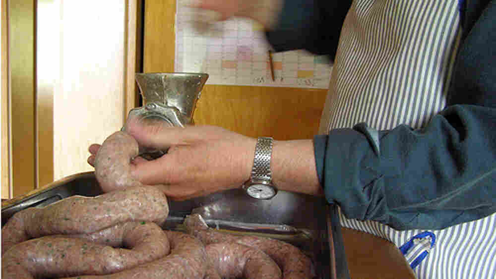 A man captures the process of putting together hand-made sausage.