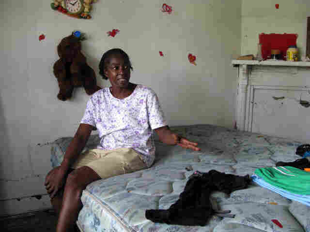 "Alondis ""Peaches"" Jackson sits on a mattress in the abandoned New Orleans home where she squats"