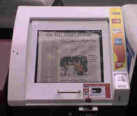 Buy your newspaper with a credit card