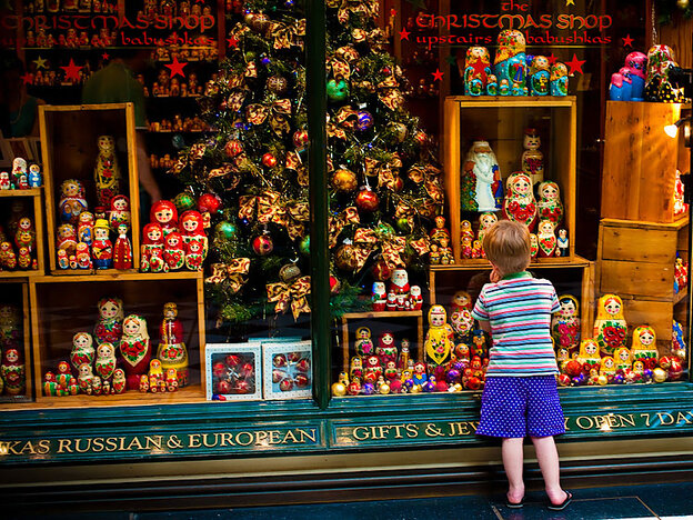 A child stands outside a Christmas shop in Australia