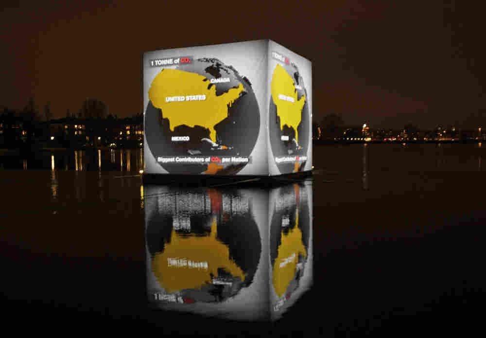A floating cube in Copenhagen shows video from the current Climate Conference