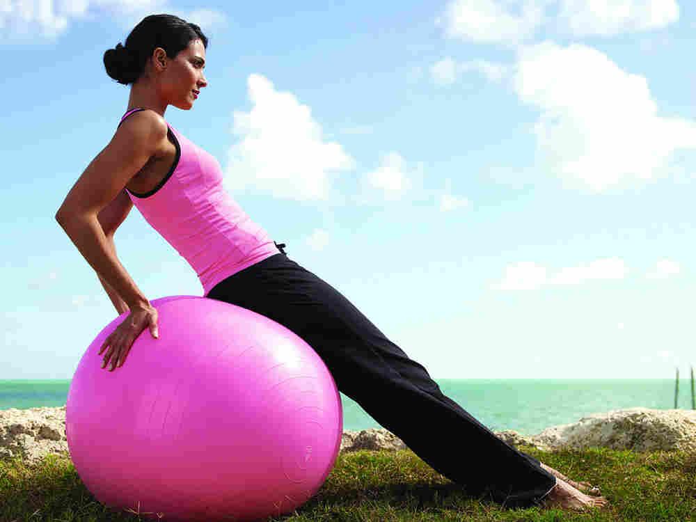 Girl exercising on ball.