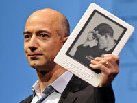 Amazon CEO Jeff Bezos and a Kindle. Emmanuel Dunand/AFP/Getty Images