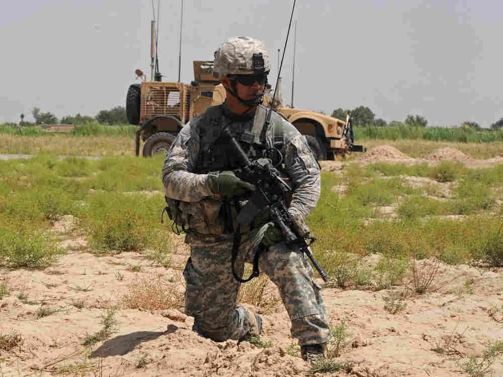 A U.S. soldier on patrol in Belanday village, Dand district in Kandahar.