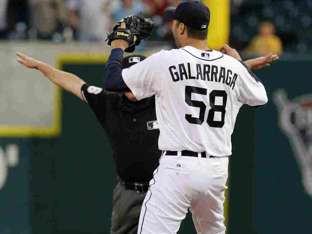 Detroit Tigers pitcher Armando Galarraga (#58) looks at first base umpire Jim Joyce.