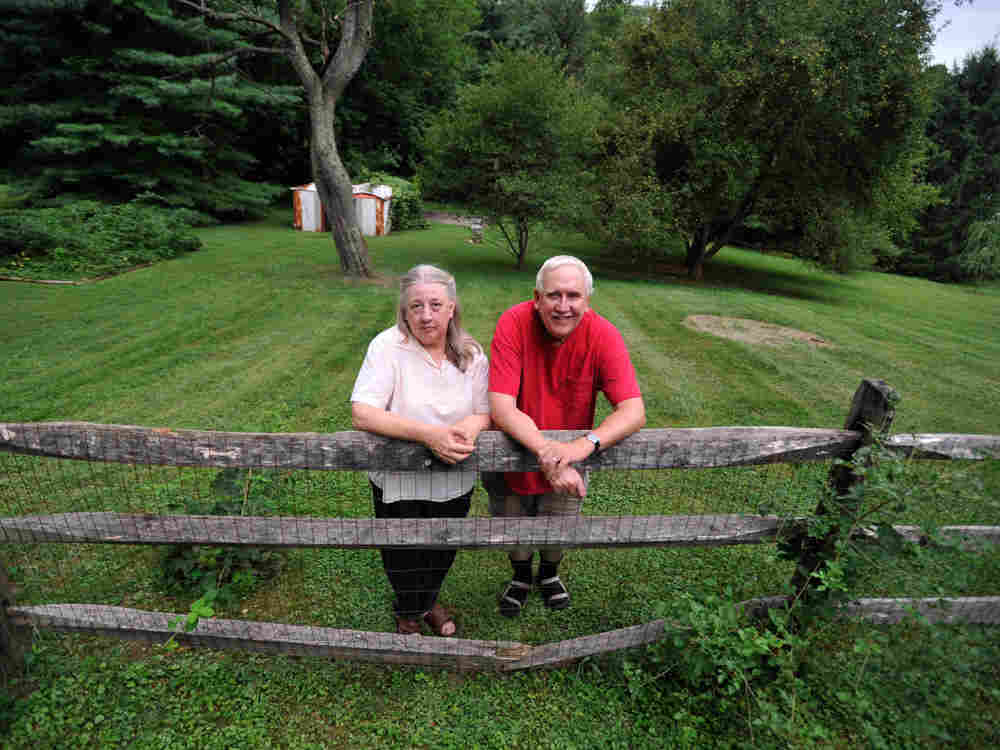 Paul Skidmore stands with his wife, Kathy, at their home in Finksburg, Md.