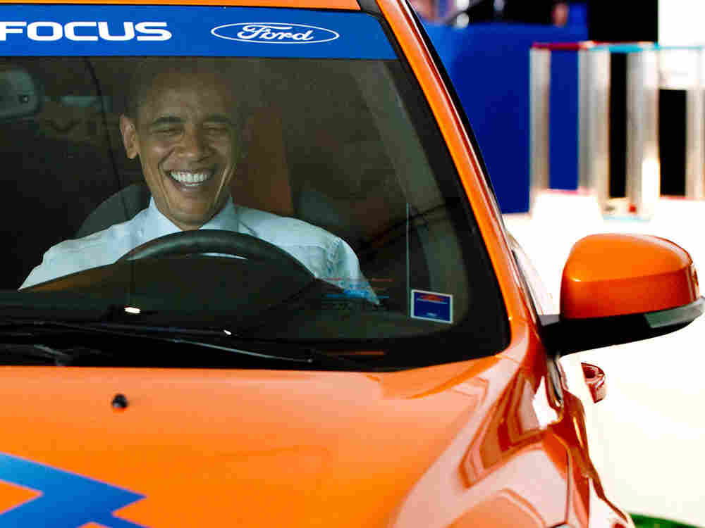 U.S. President Barack Obama sits in an electric Ford Focus
