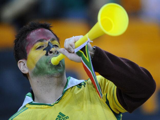 A Ghana supporter blows a vuvuzela.