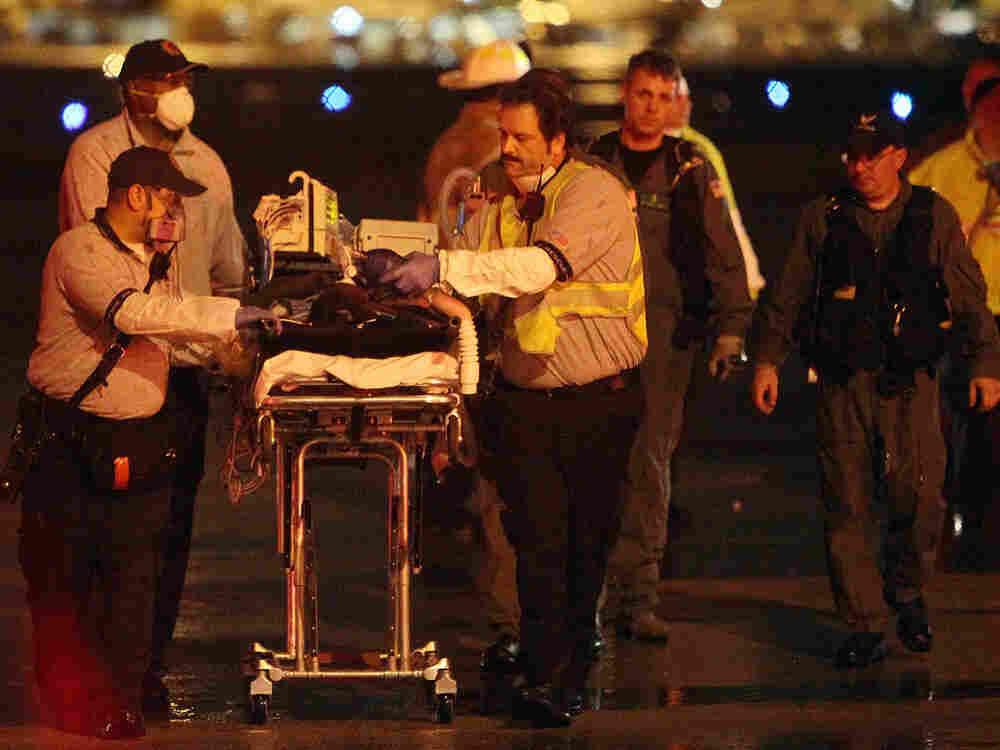 Paramedics assist after the Haiti earthquake in February, 2010