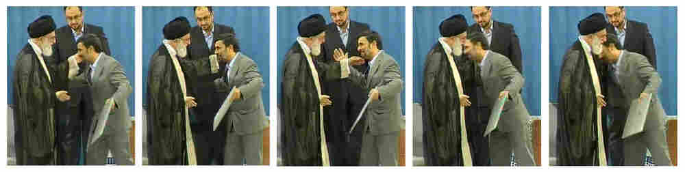 Iranian President Mahmouhd Ahmadinejad appears to be rebuffed when he tries to kiss the hand of the