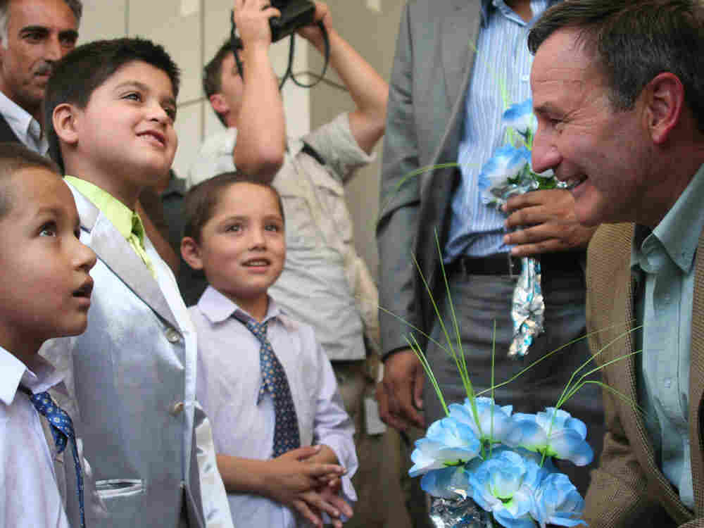 A children's choir serenades Ambassador Karl Eikenberry on his arrival in Mazar-I-Sharif. After pres