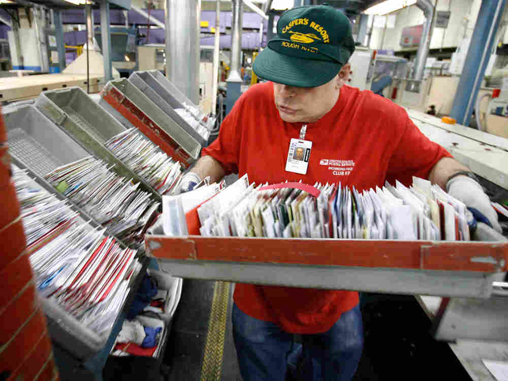 postal service worker processes mail.