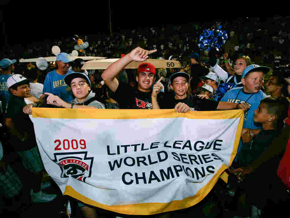 Aug. 31: Chula Vista, Calif., little league baseball players hold up a championship banner at a rall