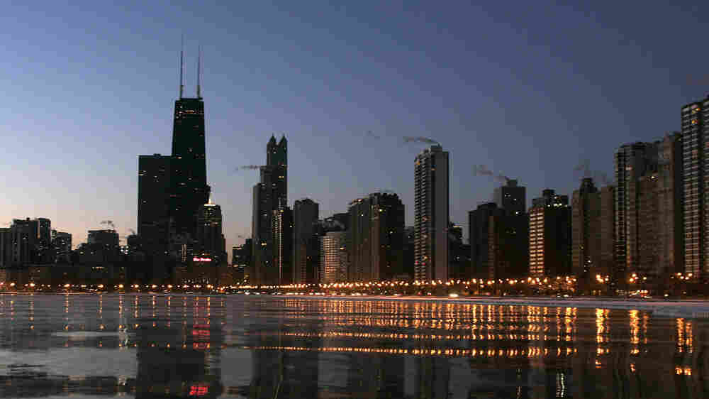 The Chicago skyline glows along Lake Michigan, February 2007(Jeff Haynes/AFP/Getty Images)