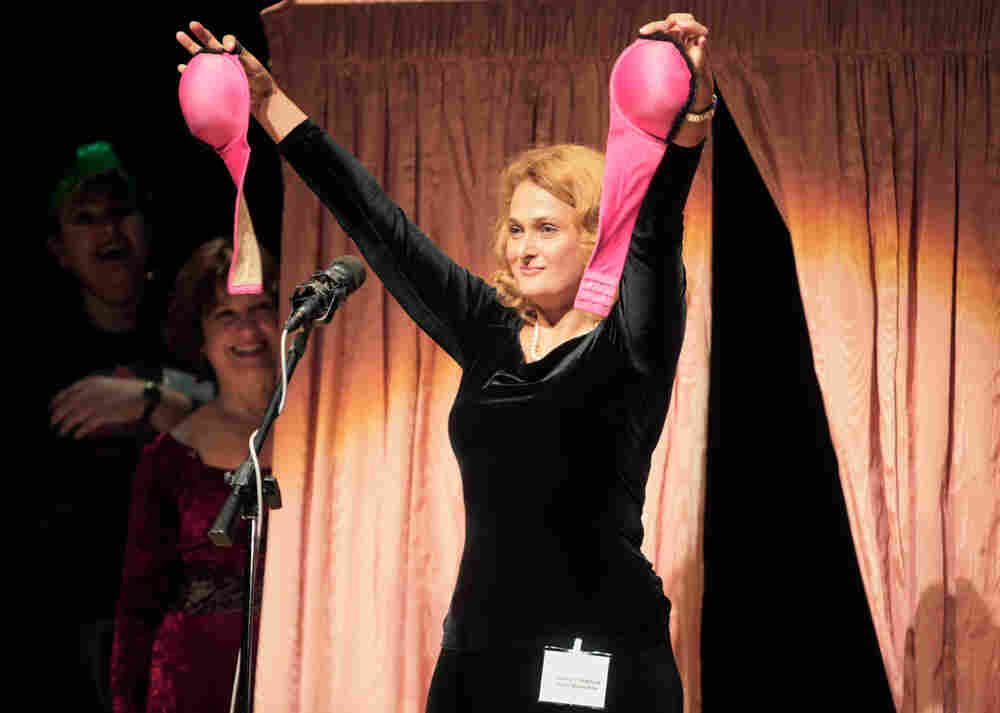 IgNobel Prize winner holds bra-gask masks.