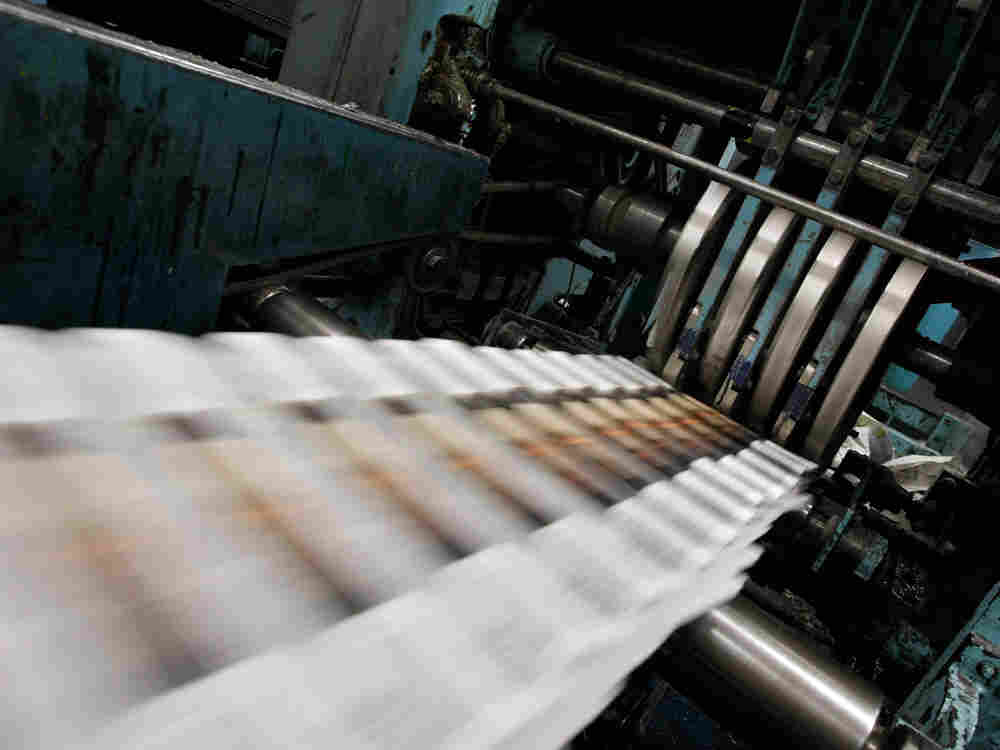 Freshly printed copies of the San Francisco Chronicle roll off the printing press at one of the Chro