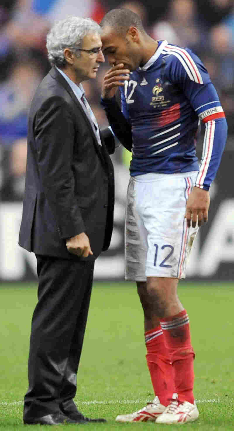 French coach Raymond Domenech (L) speaks with French forward Thierry Henry at the end during the Wor