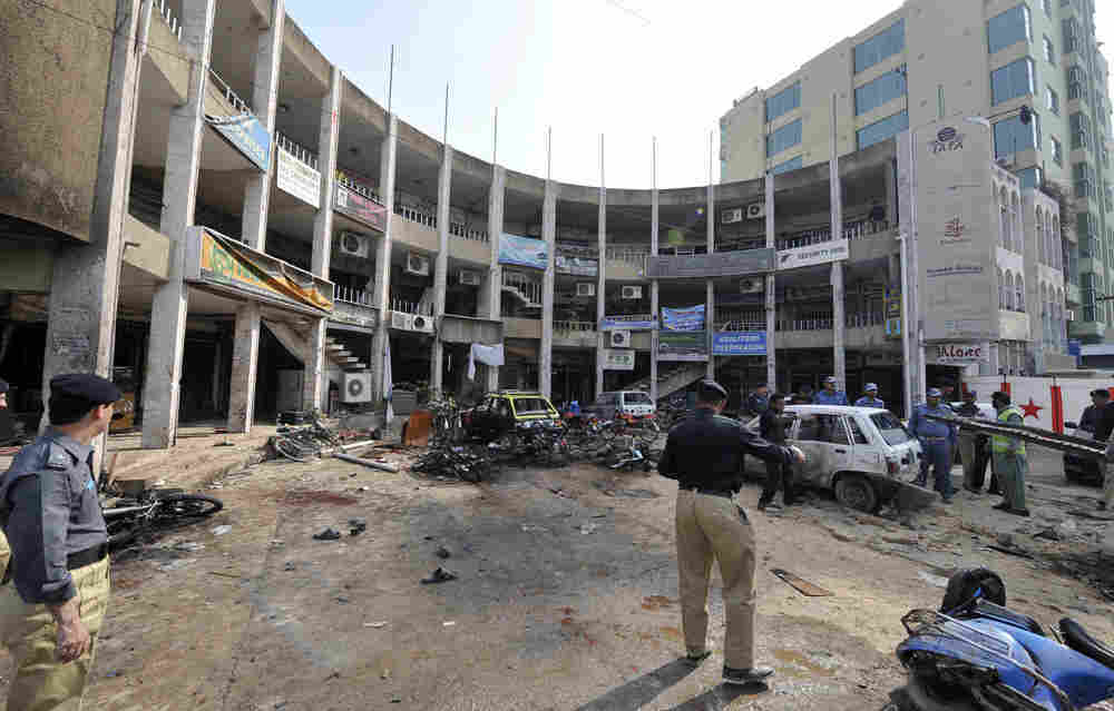 Pakistani policemen secure the site after a suicide bomb blast in Rawalpindi on November 2, 2009. (A