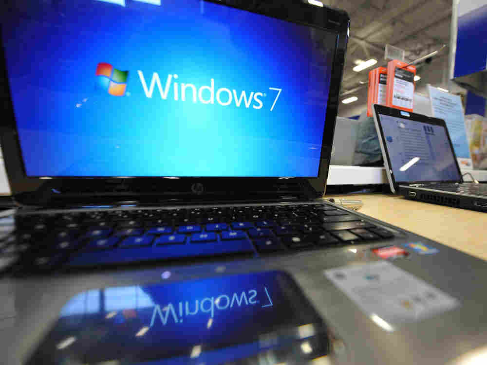 A Windows 7 logo appears on a computer on display at an electronics store in Los Angeles, California