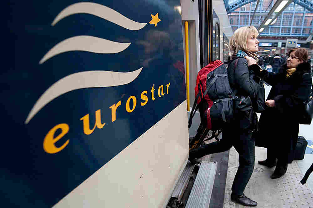 Passengers arrive on a Eurostar train from Paris to Kings Cross St Pancras station in London, after