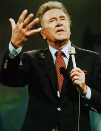 In this 1987 file photo, televangelist Oral Roberts gestures as he speaks. (AP Photo, File)
