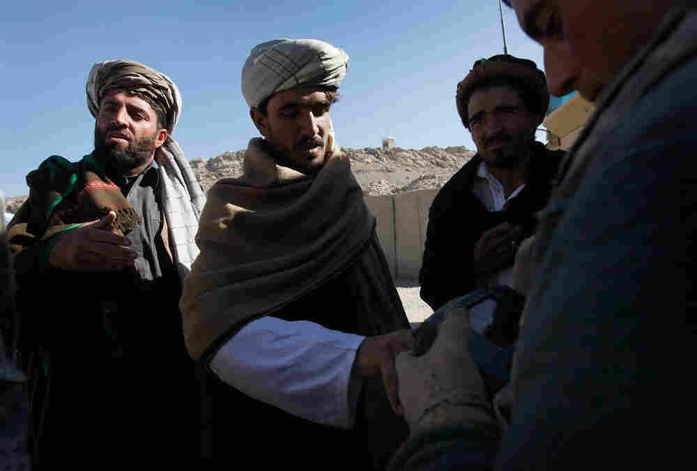 US soldier fingerprints Afghans.