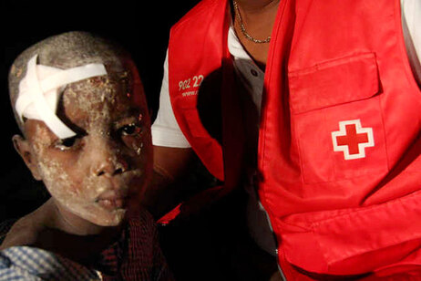 Haitian child with Red Cross worker.