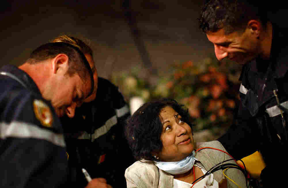 Sarla Chand, age 65, from New Jersey, is rescued by teams from Spain, France and the Urban Search an