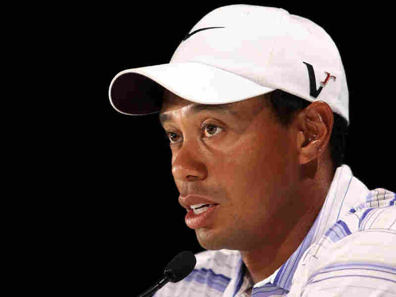 Tiger Woods speaks to the media at a press conference after round three of the 2009 Australian Maste