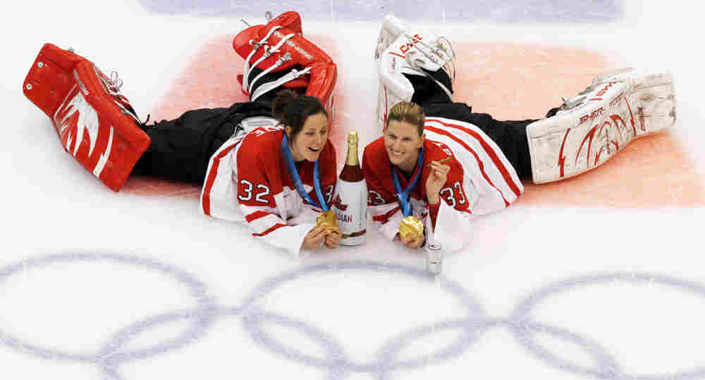 Canada goalies Charline Labonte (32) and Kim St-Pierre (33) pose for a picture at center ice for Mar