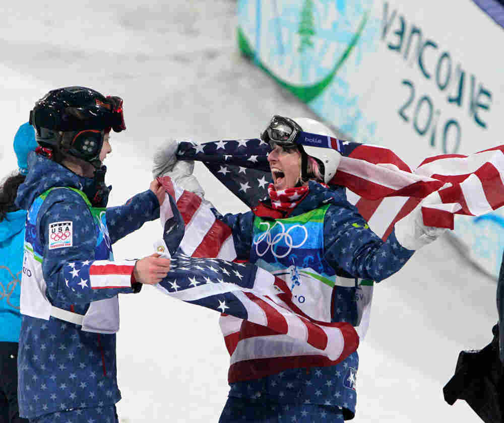 Hannah Kearney of the USA, Olympic champion in women's moguls is congratulated by third placed Shann