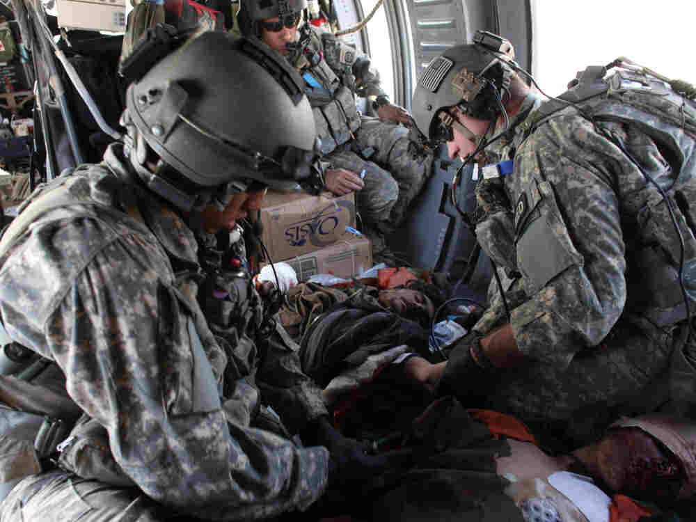 Injured Taliban fighters receive medical treatment after they were captured. Aboard a Blackhawk heli