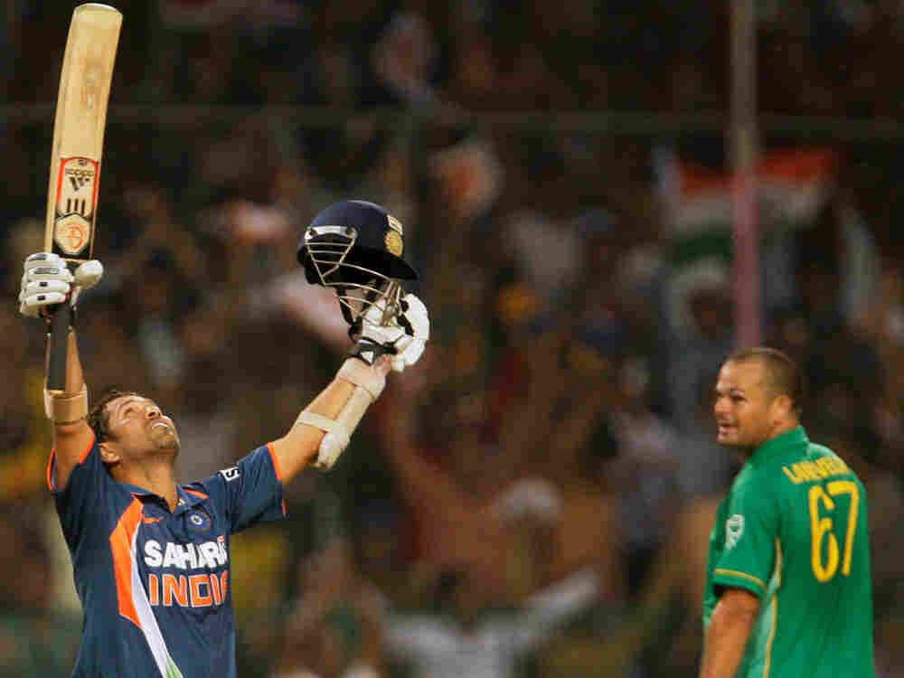 South African Charl Langeveldt, right looks on as India's Sachin Tendulkar, who scored his double-ce