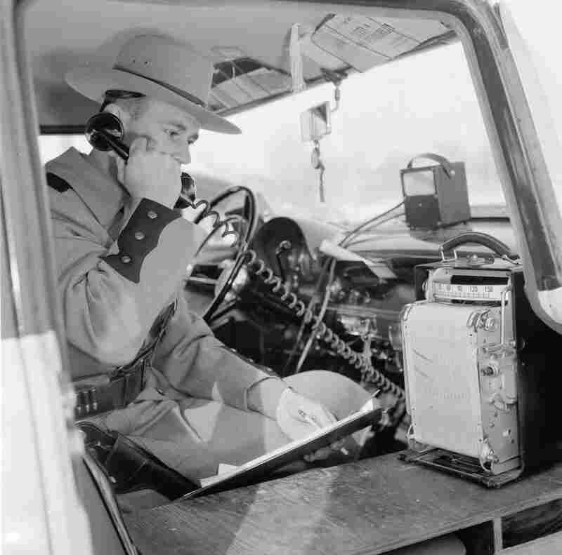 circa 1956: A New York State Trooper calls in, having just detected a speeding motorist. (Photo by T