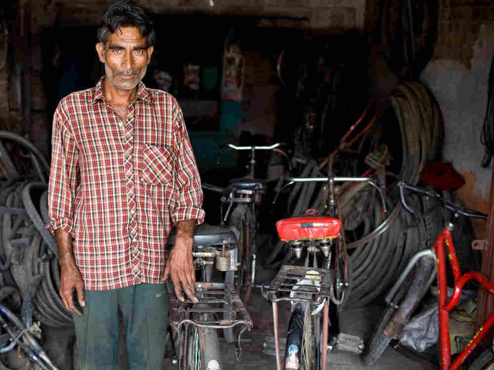 A bike shop owner in Aligarh. (Kainaz Amaria for NPR)