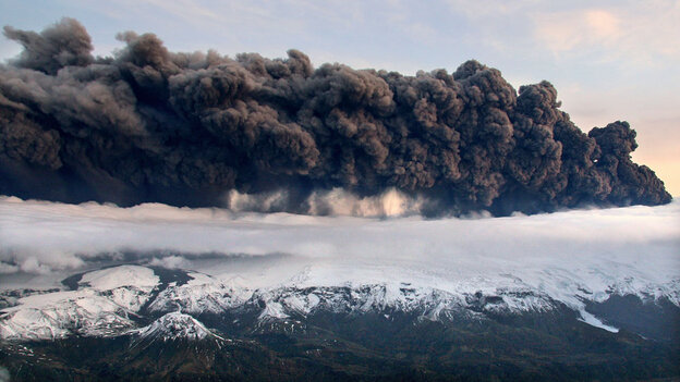 Smoke and steam hangs over the volcano under the Eyjafjallajokull glacier in Iceland, Wednesday Apri