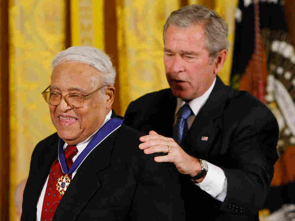 President Bush, right, presents the Presidential Medal of Freedom to Civil Rights pioneer Benjamin H