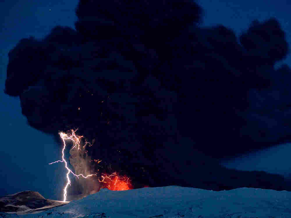 Lighting seen amid the lava and ash erupting from the vent of the Eyjafjallajokull volcano in centra
