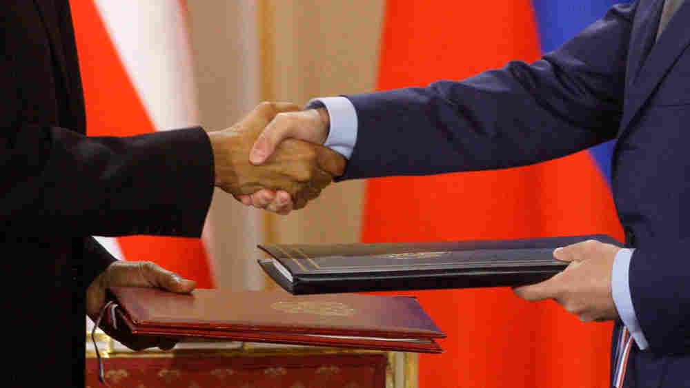 U.S. President Barack Obama, left, shake hands with his Russian counterpart Dmitry Medvedev, right,