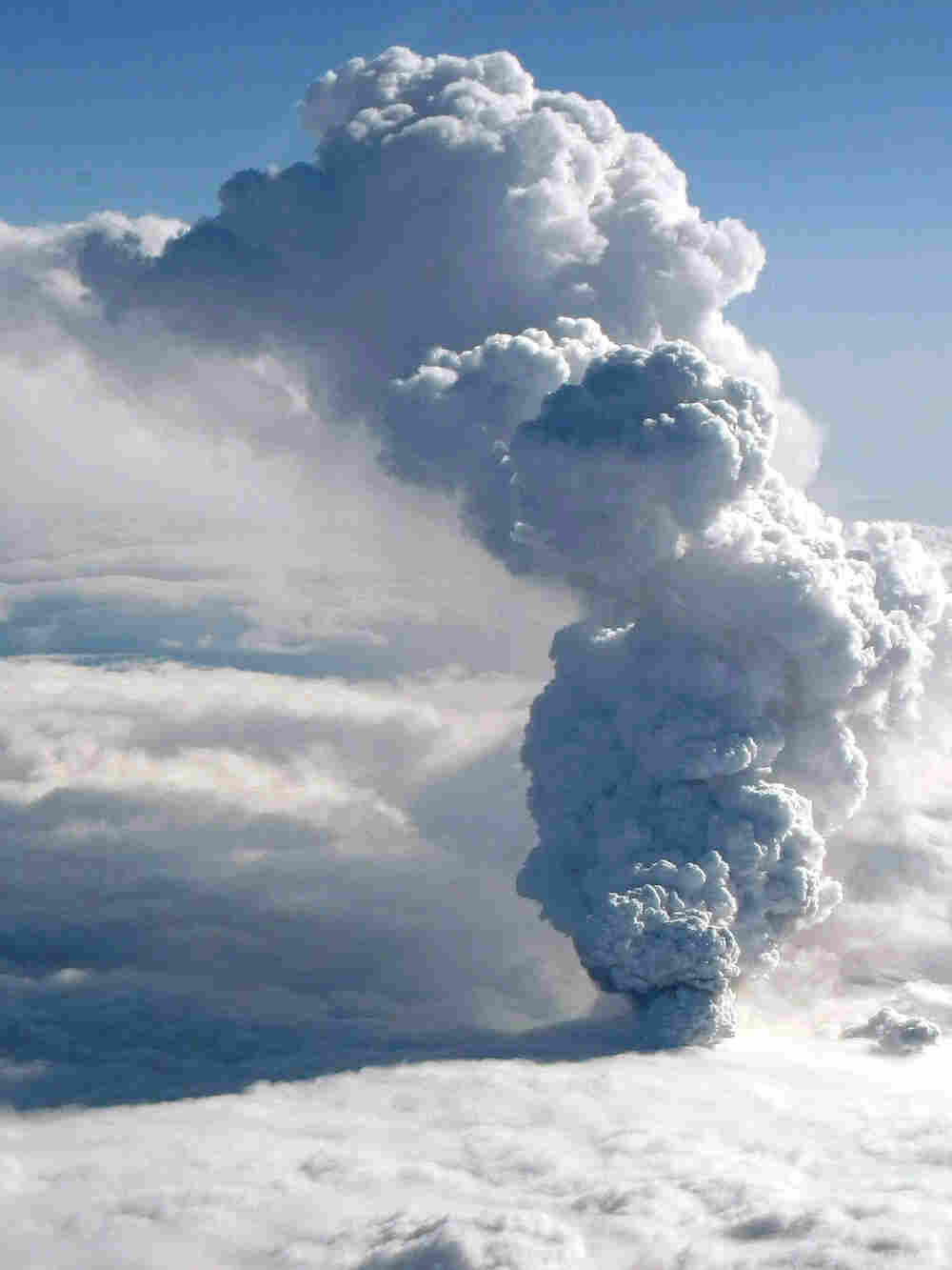 In this image made available by the Icelandic Coastguard taken Wednesday April 14, 2010, smoke and s