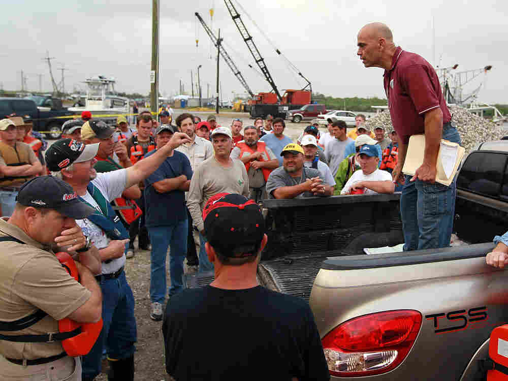 SHELL BEACH, LA - MAY 02: John Rahaim speaks with fishermen that will head out on their boats to hel