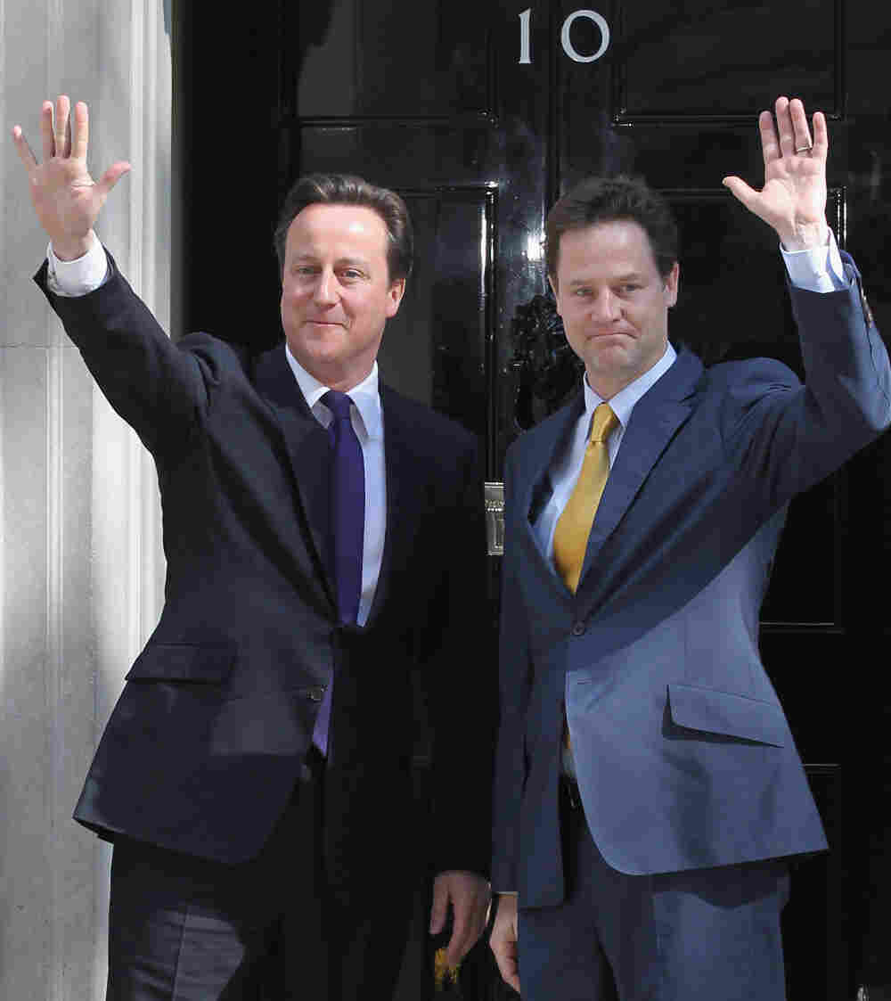 Prime Minister David Cameron greets Deputy Prime Minister Nick Clegg at the door of No. 10 Downing S