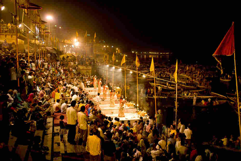 Crowds of worshipers gather at the Dashashwamedh Ghat for an evening pooja ceremony in Varanasi, Ind