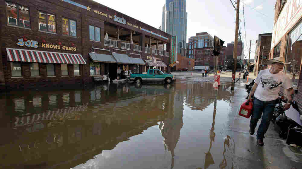 Downtown businesses are reflected in flood waters from the Cumberland River, Wednesday, May 5, 2010,