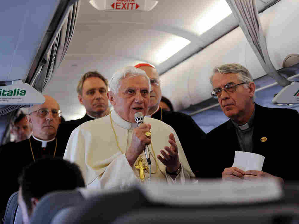 Pope Benedict XVI gestures during his speech aboard a plane on the way to Portugal on May 11, 2010.
