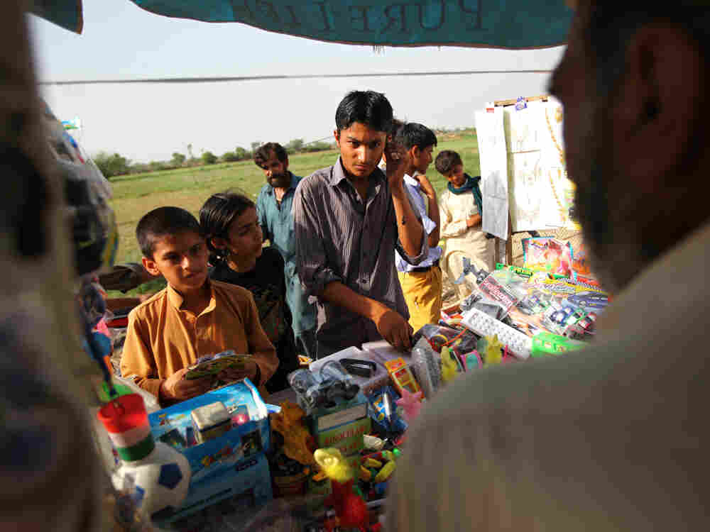 Mohammad Shoib, 16, sells little gifts at a stand near the border with India. (Photo by John Poole/N