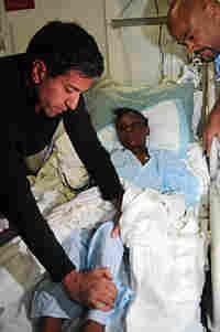 Chief CNN Medical Correspondent Dr. Sanjay Gupta examines an injured Haitian girl in the medical fac