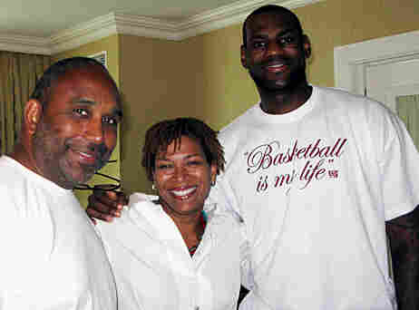 Host Michel Martin (center) poses with NBA star LeBron James of the Cleveland Cavaliers (right) and