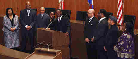 New Detroit City Council member Andre Spivey (center at podium) addresses the media, on Monday.